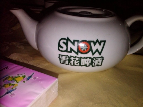 A teapot with a beer logo. why not